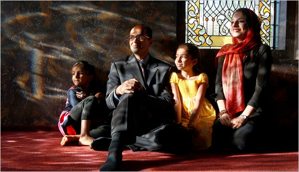 Dr. Ferhan Asghar at a Muslim center in West Chester, Ohio, with his wife, Pakeeza, and daughters Zara, left, and Emaan.