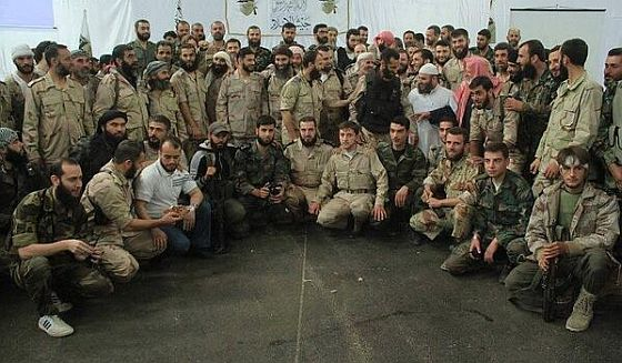 Jaish al-Islam commanders from  50 insurgent groups who merged on Sunday.