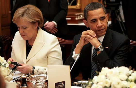 Obama pretending he can't see Merkel's text message.