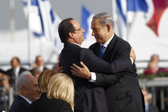 Hollande recoils slightly from Netanyahu's suffocating embrace.